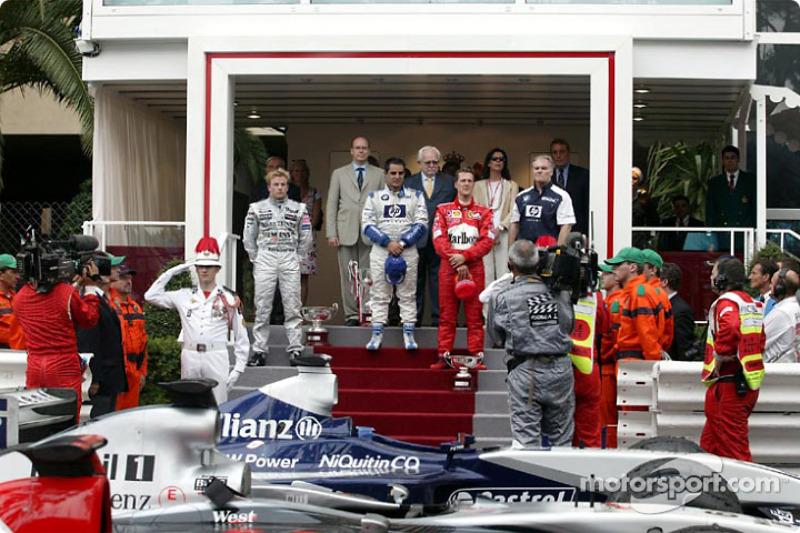 Podio: ganador de la carrera Juan Pablo Montoya, Kimi Raikkonen y Michael Schumacher