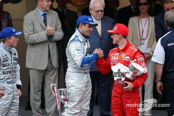 The podium: race winner Juan Pablo Montoya with Kimi Raikkonen and Michael Schumacher