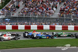 First corner: Heinz-Harald Frentzen, Nick Heidfeld and Jacques Villeneuve, three-wide