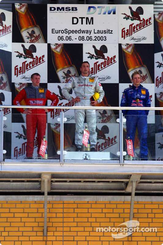 The podium: race winner Bernd Schneider with Peter Dumbreck and Mattias Ekström