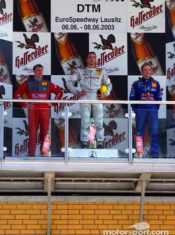The podium: race winner Bernd Schneider with Peter Dumbreck and Mattias Ekström