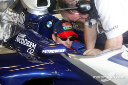 Jeff Gordon gets strapped into the FW24