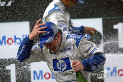 The podium: champagne shower for race winner Ralf Schumacher