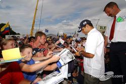 Juan Pablo Montoya signs autographs