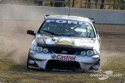 Craig Lowndes manages to get out of the gravel trap during practice