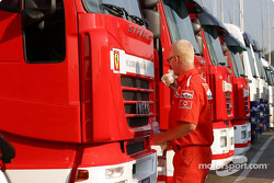 Ferrari team member washes the trucks