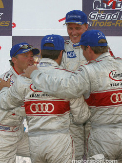 Overall and LMP900 podium: Audi drivers Frank Biela, Marco Werner, J.J. Lehto and Johnny Herbert celebrates