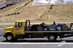 The #37 Intersport Racing Lola EX257/AER is towed from the track during Saturday's qualifying session