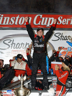Race winner Kurt Busch celebrates on victory lane