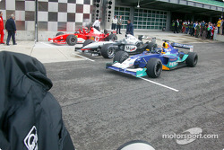 Parc fermé: race winner Michael Schumacher with Kimi Raikkonen and Heinz-Harald Frentzen