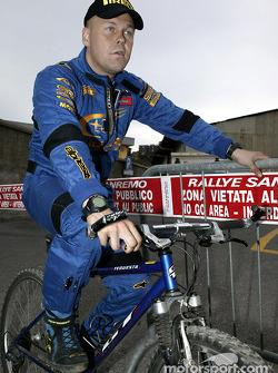 Tommi Makinen rides his bike