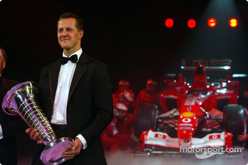 Le Champion du Monde de Formule 1 Michael Schumacher et Jean Todt avec la Ferrari F2003 GA