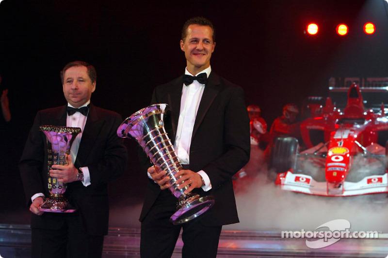 Formula One World Champion Michael Schumacher and Jean Todt with the Ferrari F2003 GA