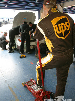 Dale Jarrett waits patiently while crew work on his car