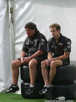 McLaren team members wait for tires