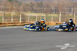 Kyle Bonsignore in the #22 kart chases the #05 of Kerry Parnell in Briggs Heavy
