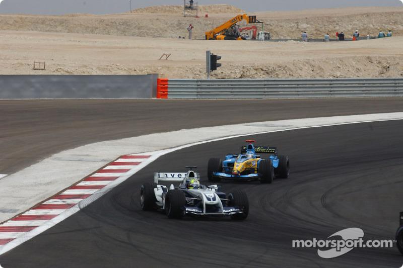 Ralf Schumacher, Williams FW26; Jarno Trulli, Renault R24