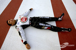 Takuma Sato rests on the track