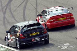 James Thompson defends from Tom CHilton