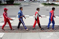 British drivers from left, Darren Manning, Mark Taylor, Dan Wheldon and Dario Franchitti re-enact the Beatles