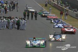 Cars leave for starting grid