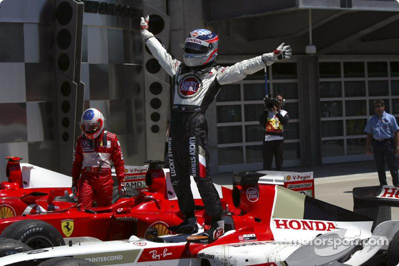 Takuma Sato celebrates third place finish