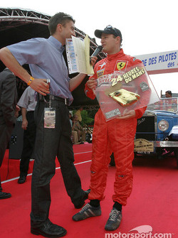 Tomas Enge receives the GTS pole winner trophy