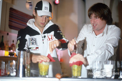 Jenson Button tries his hand at bartending