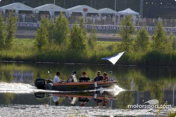 Spectators take to the water to find the best vantage points