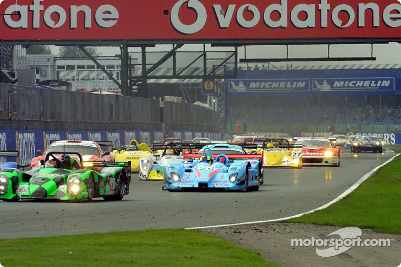 Cars enter Copse on the first lap