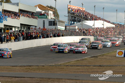 Marcos Ambrose gets the jump on Mark Skaife at the start