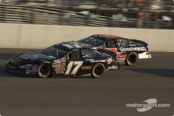 Matt Kenseth and Kevin Harvick battle on the track