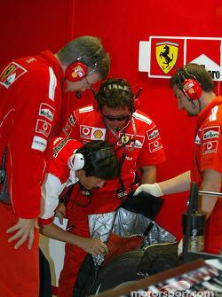 Ferrari and Bridgestone engineers check tires