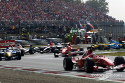 First corner: Rubens Barrichello leads the field