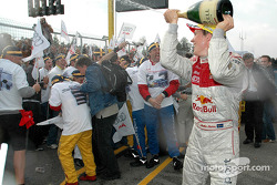 Champagne for race winner and DTM 2004 champion Mattias Ekström