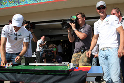 Nico Rosberg, Mercedes GP and Michael Schumacher, Mercedes GP play table football
