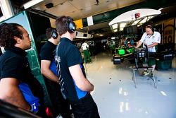 Ocean Racing Technology mechanics watch the Lotus mechanics