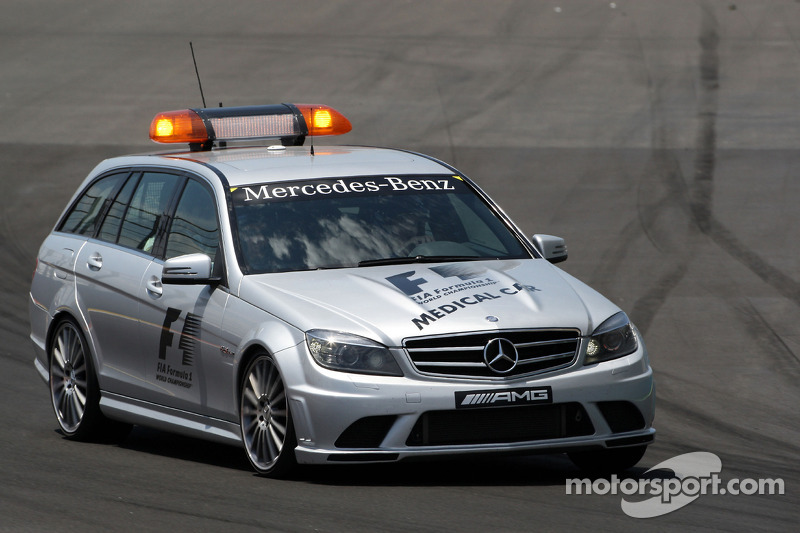 The medical car is sent to check Mark Webber, Red Bull Racing after his crash