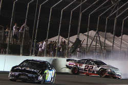 Brad Keselowski and Carl Edwards tangle coming to the checkered flag