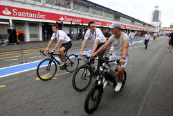 Michael Schumacher, Mercedes GP with his electric bike with Andrew Shovlin, Mercedes GP, Senior Race Engineer to Michael Schumacher