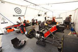 Mechanics work in the Manor garage on the cars of Adrien Tambay, Rio Haryanto and Adrian Quaife-Hobbs
