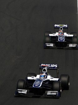Nico Rosberg, Mercedes GP leads Nico Hulkenberg, Williams F1 Team