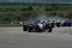 Gabriel Dias leads a gaggle of cars