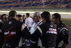 Roger Penske and Team Penske team members celebrate Helio Castroneves' win