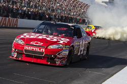 Race winner Clint Bowyer, Richard Childress Racing Chevrolet celebrates as Tony Stewart, Stewart-Haas Racing Chevrolet ran out of fuel