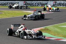 Michael Schumacher, Mercedes GP leads Nick Heidfeld, BMW Sauber F1 Team