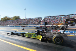 Morgan Lucas competes against Tony Schumacher during round 1