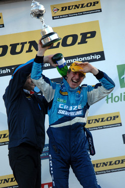 Alan Gow pours champagne down the back of Jason Plato's overalls