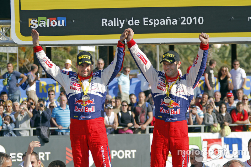 Podium: winnaars Sébastien Loeb en Daniel Elena, Citroën C4, Citroën Total World Rally Team