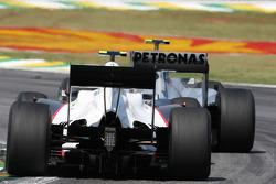 Kamui Kobayashi, BMW Sauber F1 Team and Nico Rosberg, Mercedes GP